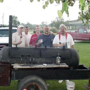 Cooking BBQ for Jesup Rotary Club... We had been up all night... I used to think that was fun... LOL... We sold BBQ Boxes and made $2000.00 to pay...